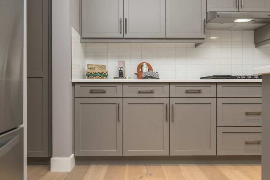 A beautiful shot of a modern house kitchen shelves and drawers