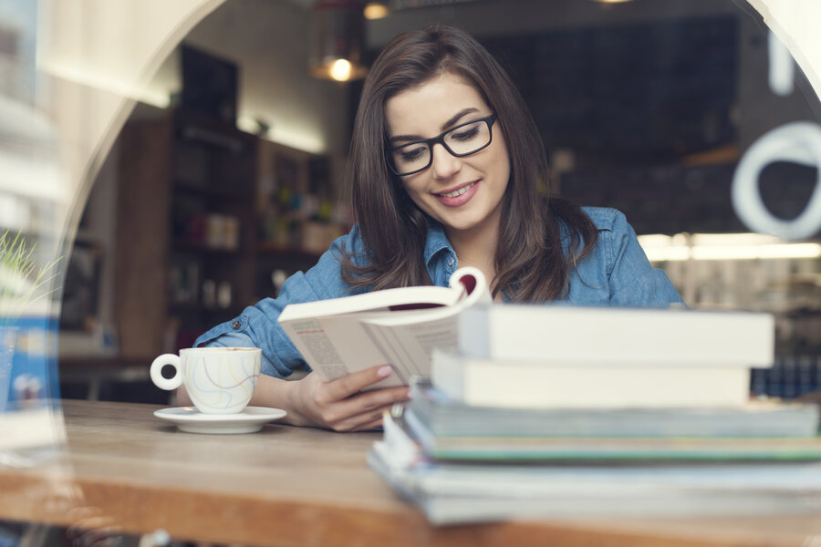 Hipster woman studying at cafe