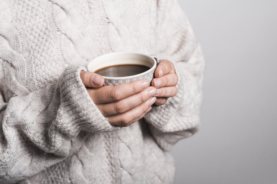 mid-section-of-woman-in-woolen-clothes-holding-coffee-cup (1) (1)